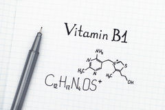 Chemical formula of Vitamin B1 with pen. Chemical formula of Vitamin B1 with black pen Royalty Free Stock Images