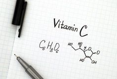 Chemical formula of Vitamin C with pen Royalty Free Stock Photo