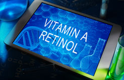 The chemical formula of Vitamin a (retinol). The chemical formula of  Vitamin a (retinol) on a tablet with test tubes Stock Photos