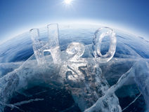 Chemical formula of water H2O. Made from ice on winter frozen lake Baikal Stock Photos