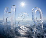 Chemical formula of water H2O. Made from ice on winter frozen lake Baikal Stock Images