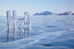Chemical formula of water H2O. Made from ice on winter frozen lake Baikal Royalty Free Stock Photos