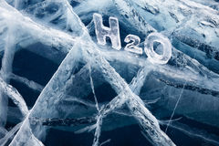 Chemical formula of water H2O. Made from ice on winter frozen lake Baikal Royalty Free Stock Photography