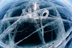 Chemical formula of water H2O. Made from ice on winter frozen lake Baikal Royalty Free Stock Image