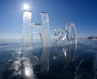 Chemical formula of water H2O. Made from ice on winter frozen lake Baikal Stock Image