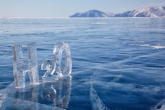Chemical formula of water H2O. Made from ice on winter frozen lake Baikal Stock Photography
