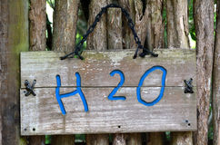 Chemical formula of water - H2O sign. The chemical formula of water  H2O on outdoor sign. Water concept Stock Photo