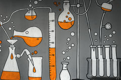 Chemical formulas drawn on the gray wall. Laboratory experiments, flasks and jars with the liquid royalty free illustration