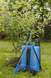 Chemical garden sprayer. Near a tree Royalty Free Stock Image