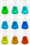 Chemical glass retorts with colorful liquid stock illustration
