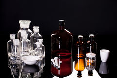 Chemical Glasses On Black Glass Royalty Free Stock Images