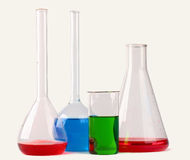 Chemical glassware with colorful liquids  on white backg Stock Images