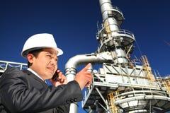Chemical industrial engineer. Industrial engineer communicate via mobile phone Royalty Free Stock Photo
