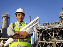 Chemical industrial engineer. With large oil refinery background Royalty Free Stock Images