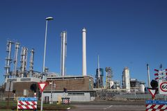 Chemical industries in the Rotterdam Botlek Harbor like refinery. And railroad crossing for port train stock photography