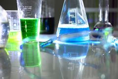 Chemical industry bulb with blue magenta. Pink liquid lab tubes stand on the table in the laboratory of liquid testing test development substances poisons Stock Photography