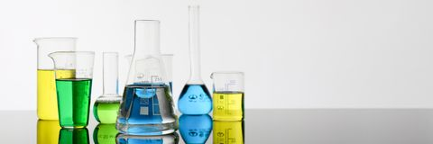 Chemical industry bulb with blue magenta. Pink liquid lab tubes stand on the table in the laboratory of liquid testing test development substances poisons Royalty Free Stock Photography