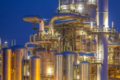 Chemical Distillation towers detail. Chemical industry distillation towers detail at night. Petrochemical background Stock Image