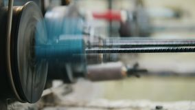 Chemical industry - fabric for fiberglass composite reinforcement - part of machinery line. Close up stock footage