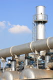 Chemical industry plant. Pipes in chemical industry over a blue sky Royalty Free Stock Photo