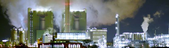 Chemical industry plant at night - building of a factory for the. Production of gasoline stock photos
