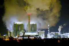 Chemical industry plant at night - building of a factory for the. Production of gasoline royalty free stock image