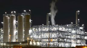 Chemical industry plant at night - building of a factory for the. Production of gasoline stock photo