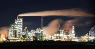 Chemical industry plant at night - building of a factory for the. Production of gasoline royalty free stock photos