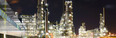 Chemical industry plant at night - building of a factory for the. Production of gasoline royalty free stock photo