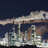 Chemical industry plant at night - building of a factory for the. Production of gasoline stock images