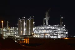 Chemical industry plant at night - building of a factory for the. Production of gasoline stock photography