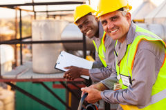 Chemical industry technicians. Two oil and chemical industry technicians in plant Stock Image