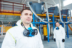 Chemical industry workers at factory. Two chemical industry workers at industrial factory Royalty Free Stock Images