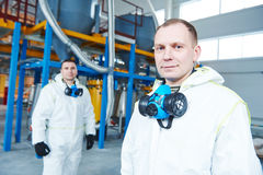 Chemical industry workers at factory royalty free stock photo