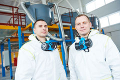 Chemical industry workers at factory. Two chemical industry workers at industrial factory Stock Image