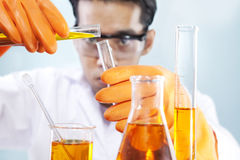 Chemical lab research. Scientist is doing his chemical lab research Royalty Free Stock Images