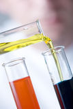 Chemical laboratory scene - careful Stock Images