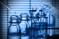 Chemical Laboratory,scientist Dropping The Reagent Into Test Fla Stock Images