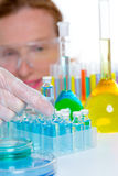 Chemical laboratory scientist woman with bottles Royalty Free Stock Images