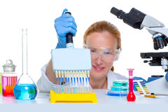Chemical laboratory scientist woman multi channel pipette Royalty Free Stock Photography