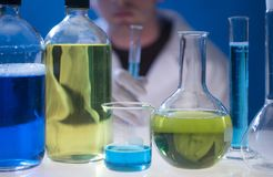 Chemical lab - glass and worker Royalty Free Stock Photography