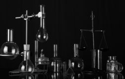 Chemical laboratory variety of flasks and test tubes, chemical scales and burner. Black-and-white photograph. Chemical laboratory a variety of laboratory flasks royalty free stock photography