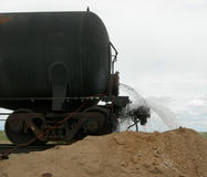 Chemical Leak from a Railcar. Chemical leak is occuring from a railcar and spewing out of the back Royalty Free Stock Photos
