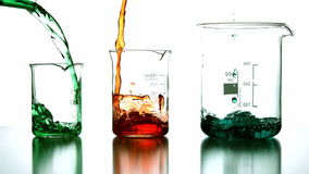 Chemical liquids pouring into beaker stock video footage