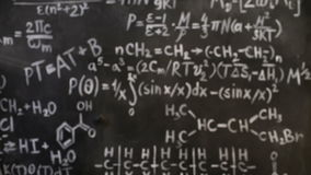 Chemical and mathematical equations wall room background focused and defocused action stock video