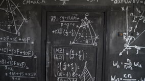 Chemical and mathematical equations wall room background paning. Chemical and mathematical equations wall room background interior stock footage