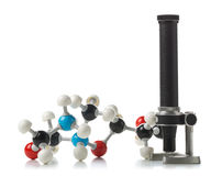 Chemical molecule model with old microscope over white backgroun Royalty Free Stock Photography