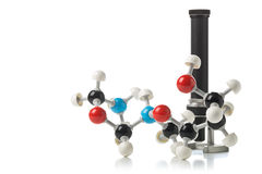 Chemical molecule model with old microscope over white backgroun Stock Images