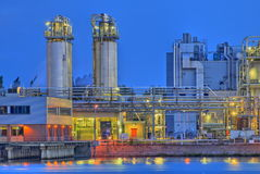 Chemical night scene. Part of a large chemical production facility at night Stock Photos