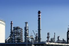 Chemical oil plant equipment petrol distillery. Skyline stock image